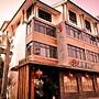 Jiuyue Meisu Yangu Huaxiang Hotel